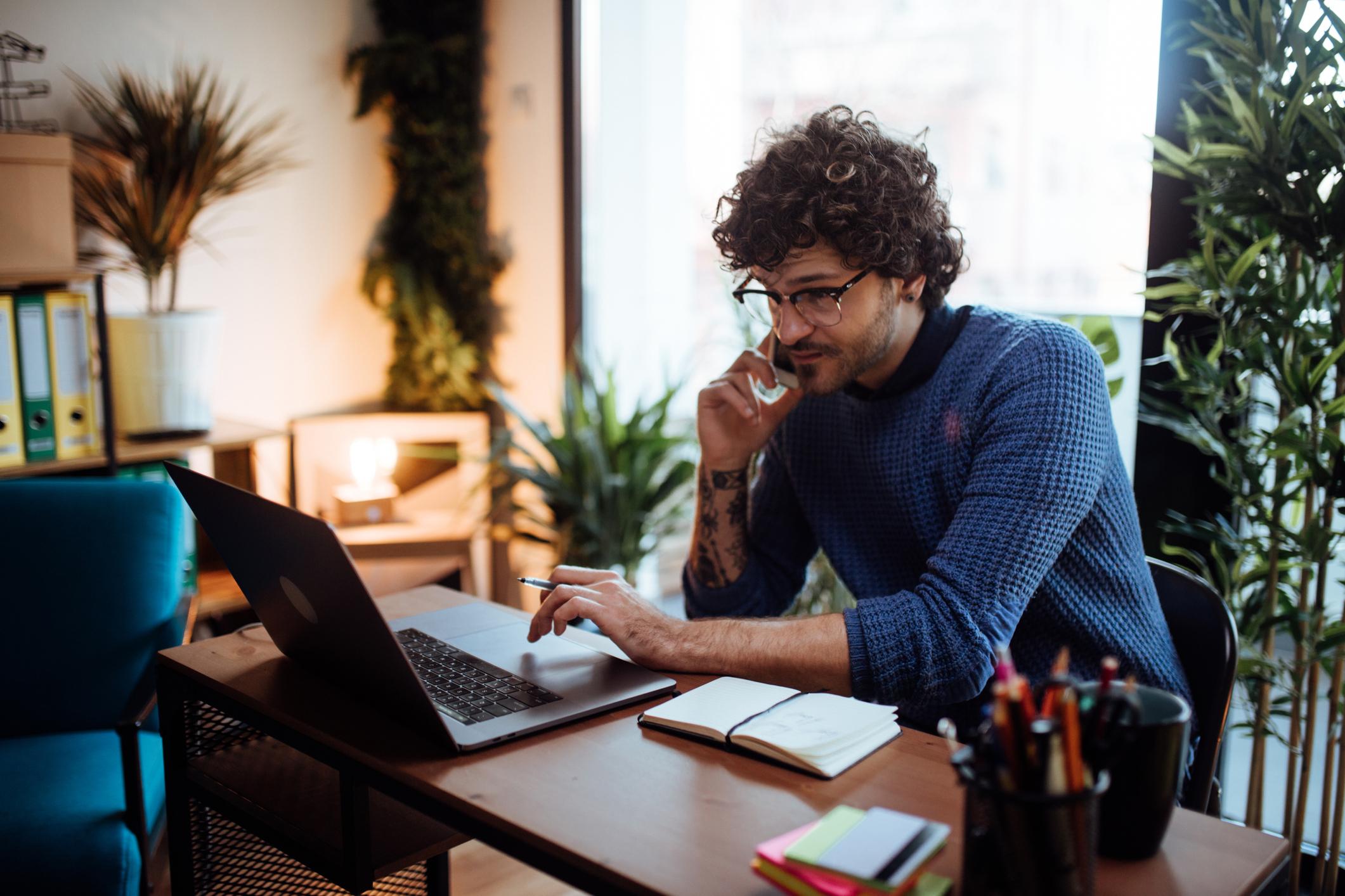 man-laptop-phone
